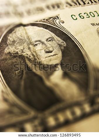 George Washington on a one dollar bil. Tilt-shift lens. - stock photo