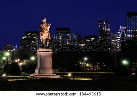 George Washington statue in Boston Public Garden and city skyline at night - stock photo