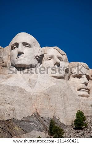George Washington, Thomas Jefferson, and Theodore Roosevelt at Mt. Rushmore National Memorial - stock photo