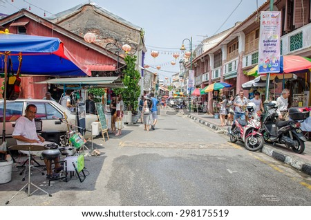 Georgetown,Penang - July 17,2015 : People can seen walking and exploring around the street art in Georgetown, Penang
