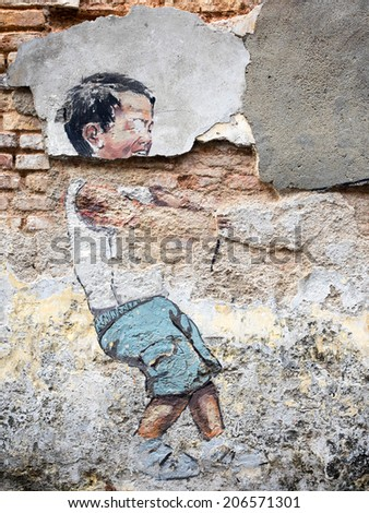 """Georgetown, Penang, Malaysia - April 23, 2014: Close-up of """"Little Boy with Pet Dinosaur"""" street art piece in George Town, Penang, Malaysia.  - stock photo"""
