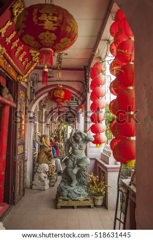 GEORGETOWN, PENANG, MALAYSIA - AUGUST 06, 2016: Red lanterns and monkey king statue at the entrance of the old shopbuilding in Georgetown, Penang, Malaysia