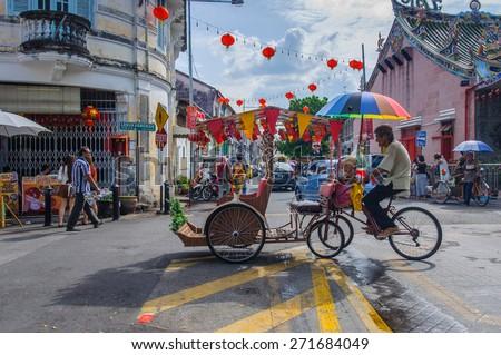 Georgetown, Penang, Malaysia - February 19, 2015: Classic local rickshaw in George Town, Penang, Malaysia. - stock photo