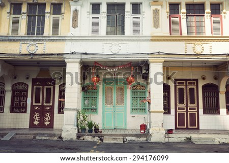 Georgetown, Penang, Malaysia  - JULY 1, 2015 Traditional Malaysian colonial houses on a street in Georgetown - stock photo