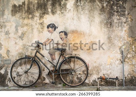 Georgetown, Penang, Malaysia - March 1, 2015: Famous graffiti of little children on a bicycle in Georgetown, Penang by Lithuanian artist Ernest Zacharevic - stock photo