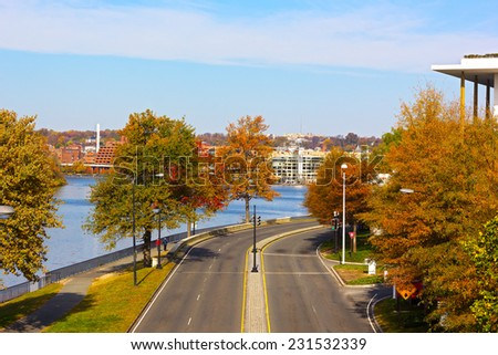 Georgetown Waterfront Park near Potomac River in Washington DC, USA. Colorful trees near the river in the autumn morning. - stock photo