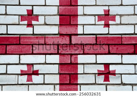 Georgia flag painted on old brick wall texture background - stock photo
