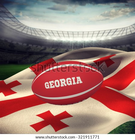 Georgia rugby ball against rugby stadium - stock photo