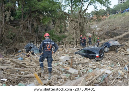 Georgia, Tbilisi, zoo. 15 june 2015: Rescuers examine the debris as a result of mudslides - stock photo