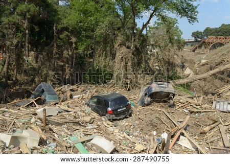 Georgia, Tbilisi, zoo. 15 june 2015: several cars in a pile of garbage at the site of the zoo after the flood - stock photo