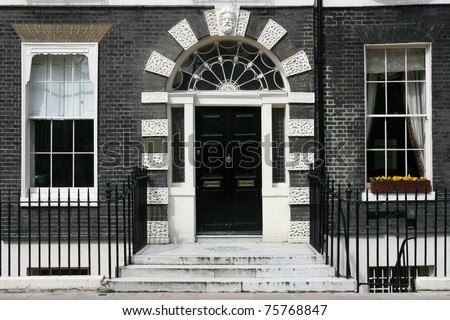 Georgian architecture of London, England - black door in old building - stock photo