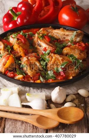 Georgian cuisine: chicken stew with vegetables on a table close-up. vertical - stock photo