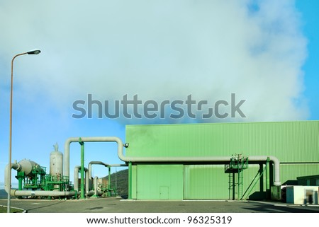 Geothermal energy. A steam coming out from a small green power plant.