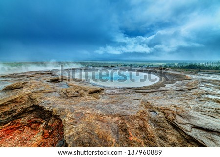 Geothermal hot water at the geysir district in Iceland. Sleeping Stori Geysir. - stock photo