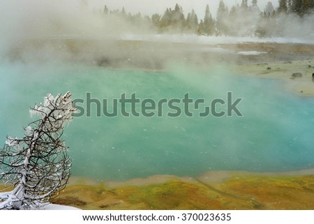 Geothermal pool in winter Yellowstone National Park - stock photo