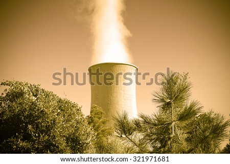 Geothermal power plant in Tuscany hills with copy space - toned image