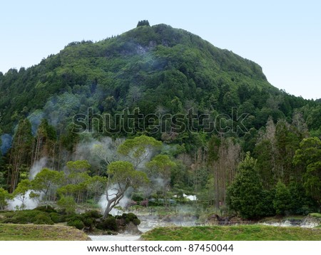 geothermic activity at stream crossing, the biggest island of the Azores Archipelago, a group of volcanic islands located in the middle of the North Atlantic Ocean (Portugal) - stock photo