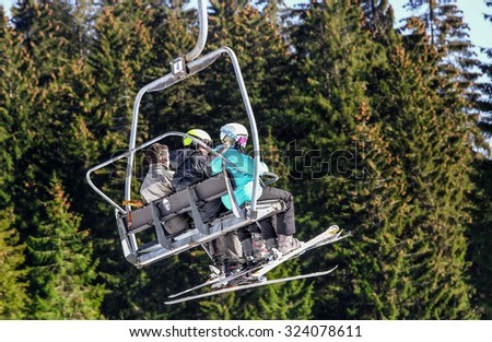 GERARDMER, FRANCE - FEB 19 - Chairlift. Ski resort during the annual winter school holiday on Feb 19, 2015 in Gerardmer, France - stock photo