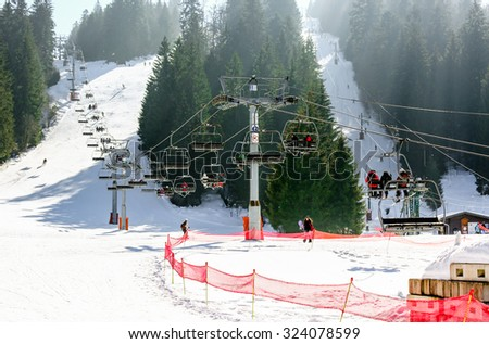 GERARDMER, FRANCE - FEB 19 - Chairlift. Ski resort large view during the annual winter school holiday on Feb 19, 2015 in Gerardmer, France - stock photo