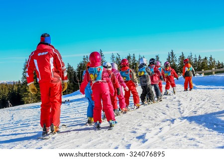 GERARDMER, FRANCE - FEB 20 - French children form ski school groups during the annual winter school holiday on Feb 20, 2015 in Gerardmer, France. - stock photo