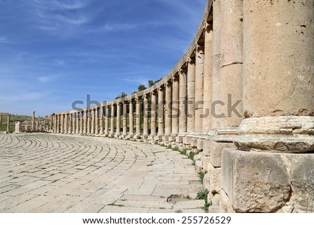 GERASA (JERASH), JORDAN- APRIL 05, 2014: Forum (Oval Plaza)  in Jerash, Jordan.  Forum is an asymmetric plaza at the beginning of the Colonnaded Street, which was built in the first century AD - stock photo