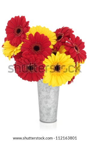 Gerbera flower arrangement red yellow old stock photo royalty free gerbera flower arrangement in red and yellow in an old aluminium vase over white background mightylinksfo
