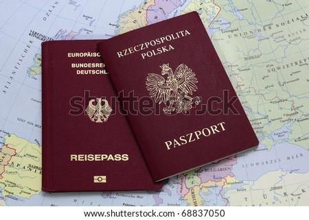 german and polish passport on the map - stock photo