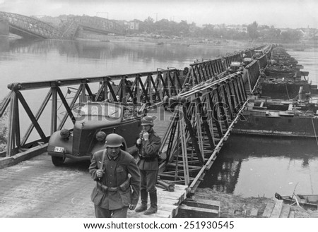 German army invades of Poland. Vehicles pass over a bridge constructed by German Army engineers crossing the Vistula River near Bydgoszcz, Poland. In the left is a destroyed bridge. Sept. 16, 1939 - stock photo