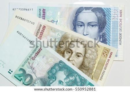 German banknotes. Deutche Mark (DM) D-mark in denominations 20, 50 and 100. Pre-euro currency which now are cancelled and invalid.