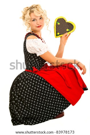 german bavarian girl in dirndl with typical oktoberfest cookie
