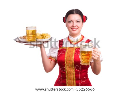 "German/Bavarian girl with a traditional Oktoberfest ""Ma?krug. Smiling woman in red drindl is holding a beer. Young woman with a beer mug, dressed in a Bavarian dirndl."