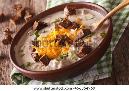 German beer soup with cheese and croutons in a bowl close-up on the table. horizontal - stock photo