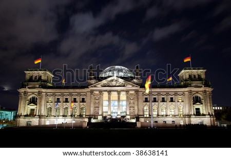 german berlin reichstag by night with deep blue sky and some clouds