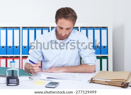 German businessman at work at office - stock photo
