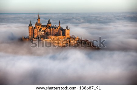 German Castle Hohenzollern over the Clouds - stock photo