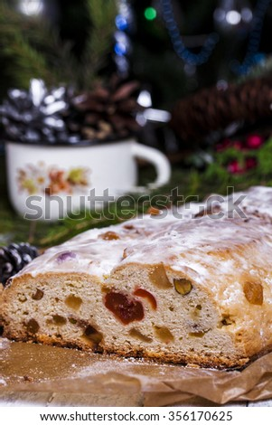 German Christmas cake Stollen with dry fruits and nuts close up on the table