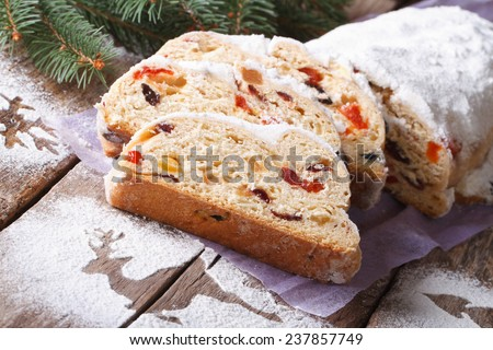 German Christmas cake Stollen with dry fruits and nuts close up on the table. horizontal  - stock photo