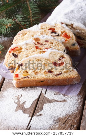German Christmas fruit cake Stollen close-up on the table. Vertical  - stock photo