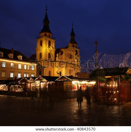 German christmas market at night with people in motion - stock photo