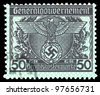 GERMAN - CIRCA 1944: A stamp printed Germany, shows eagle and swastika, series , circa 1944 - stock photo