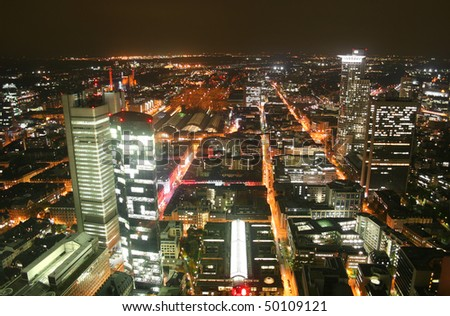 German city Frankfurt with financial district Westend and central station at night - stock photo