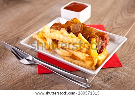 German curry sausage with french fries - stock photo
