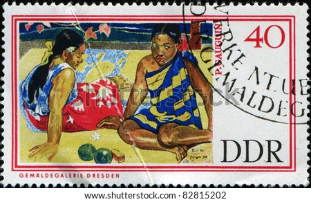 "GERMAN DEMOCRATIC REPUBLIC - CIRCA 1967: A stamp printed in GDR (East Germany) shows ""Tahitian Women on the Beach"" by Paul Gauguin, circa 1967"