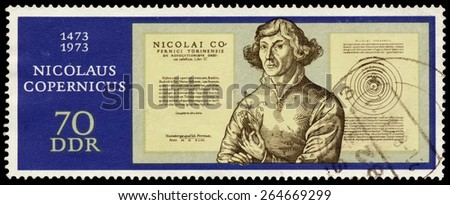 GERMAN DEMOCRATIC REPUBLIC - CIRCA 1973: Stamp printed in GDR shows Nicolaus Copernicus, from the series 500th Anniversary of the Birth of Mikolaj Kopernik, circa 1973  - stock photo