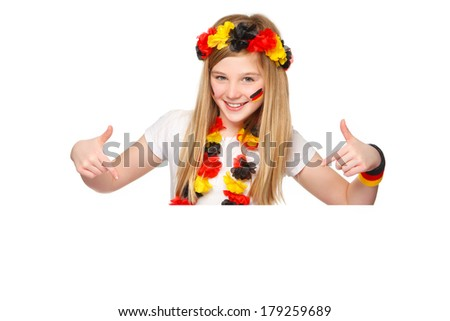 german fan pointing on a white placard with blank space for text - stock photo