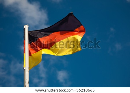 German flag against blue sky