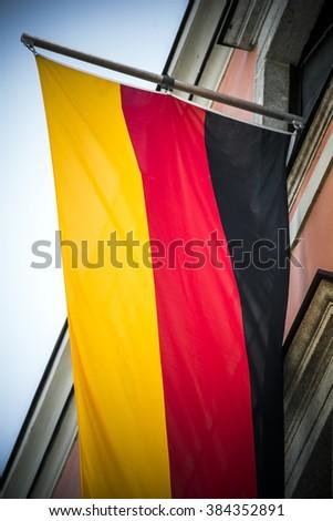 German flag banner on high building - stock photo