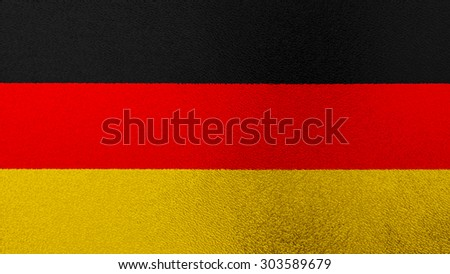 German flag on shiny glass texture - stock photo