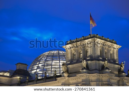 German flag on the national German parliament (Reichstag building) at evening, Berlin Government district, Germany, Europe - stock photo
