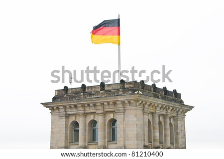 German flag on the roof of Reichstag building - stock photo